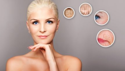 Beauty portrait face of happy smiling beautiful blond woman with blue eyes and smooth skin thinking of aging, aesthetics cosmetics skincare concept.