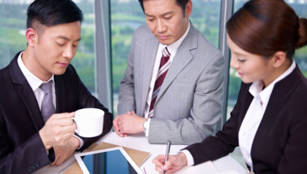 asian business people at a meeting in office.