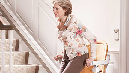 woman-rising-from-stairlift-439001