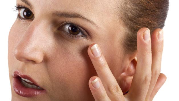 woman applying anti aging cream ointments
